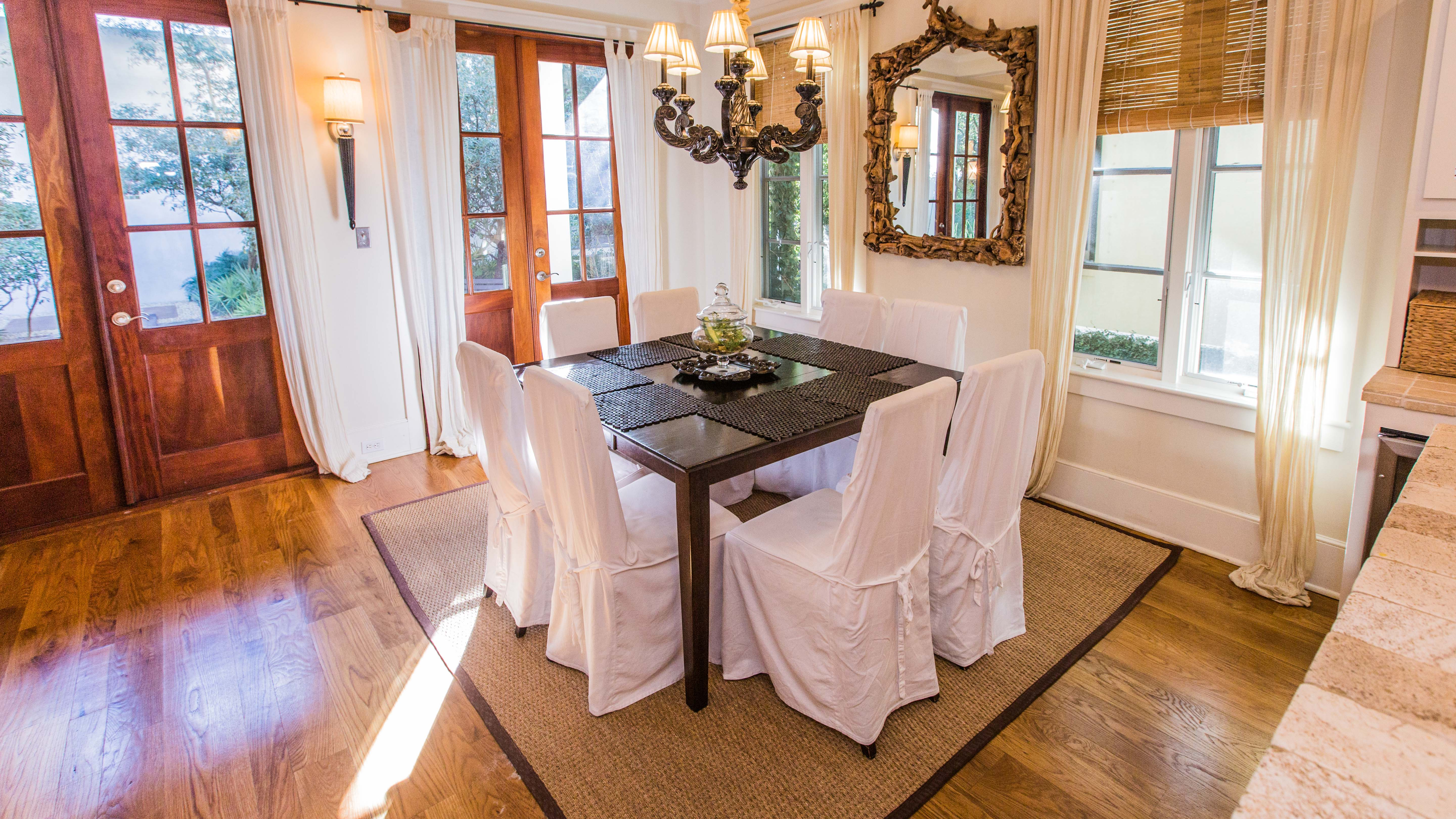 Square table seats 8 and is easily accessible to the kitchen
