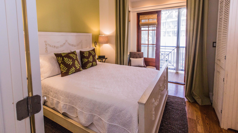 Queen bed, television, en suite bath and screened porch