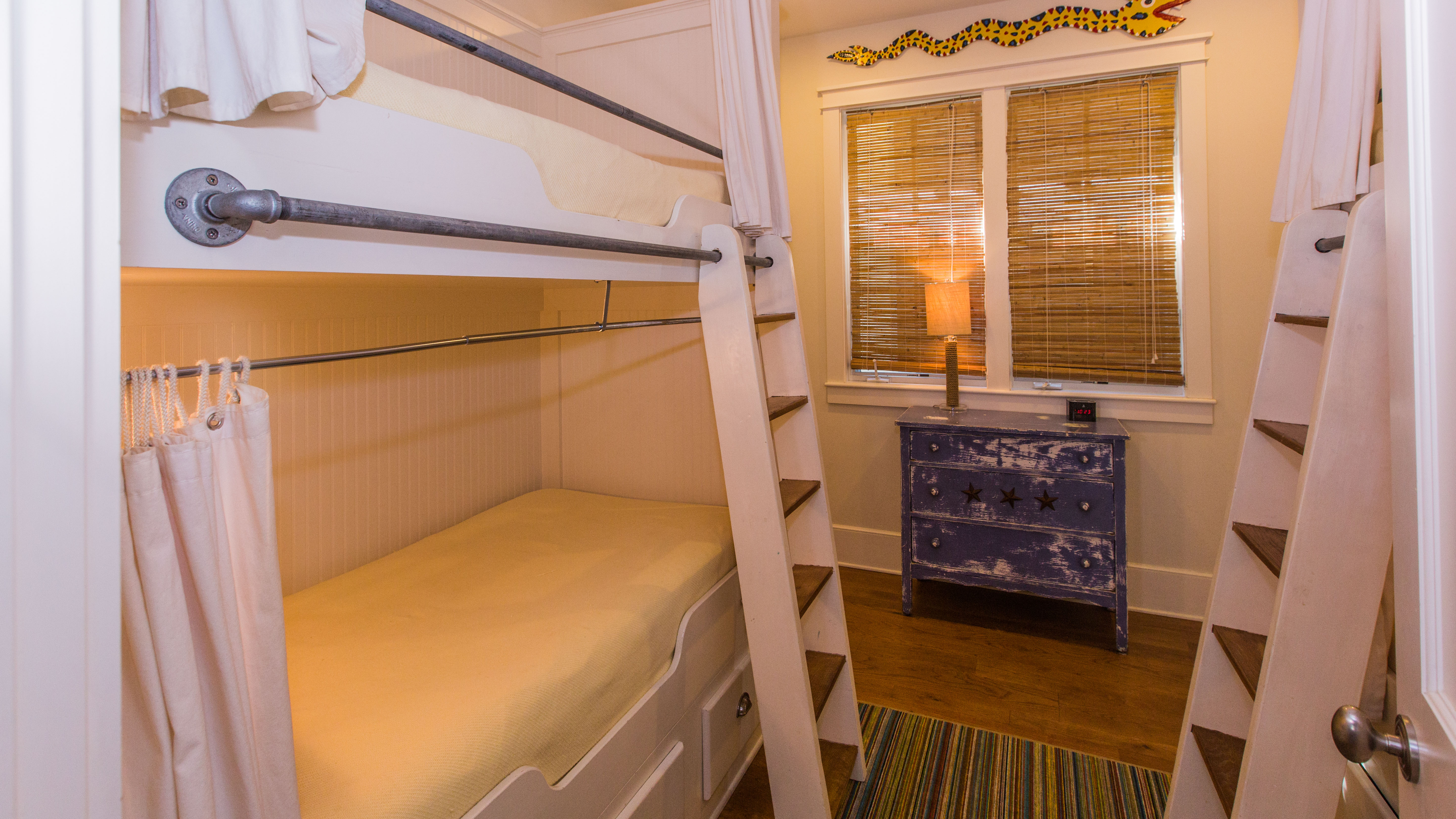 Four full sized twin beds with curtains