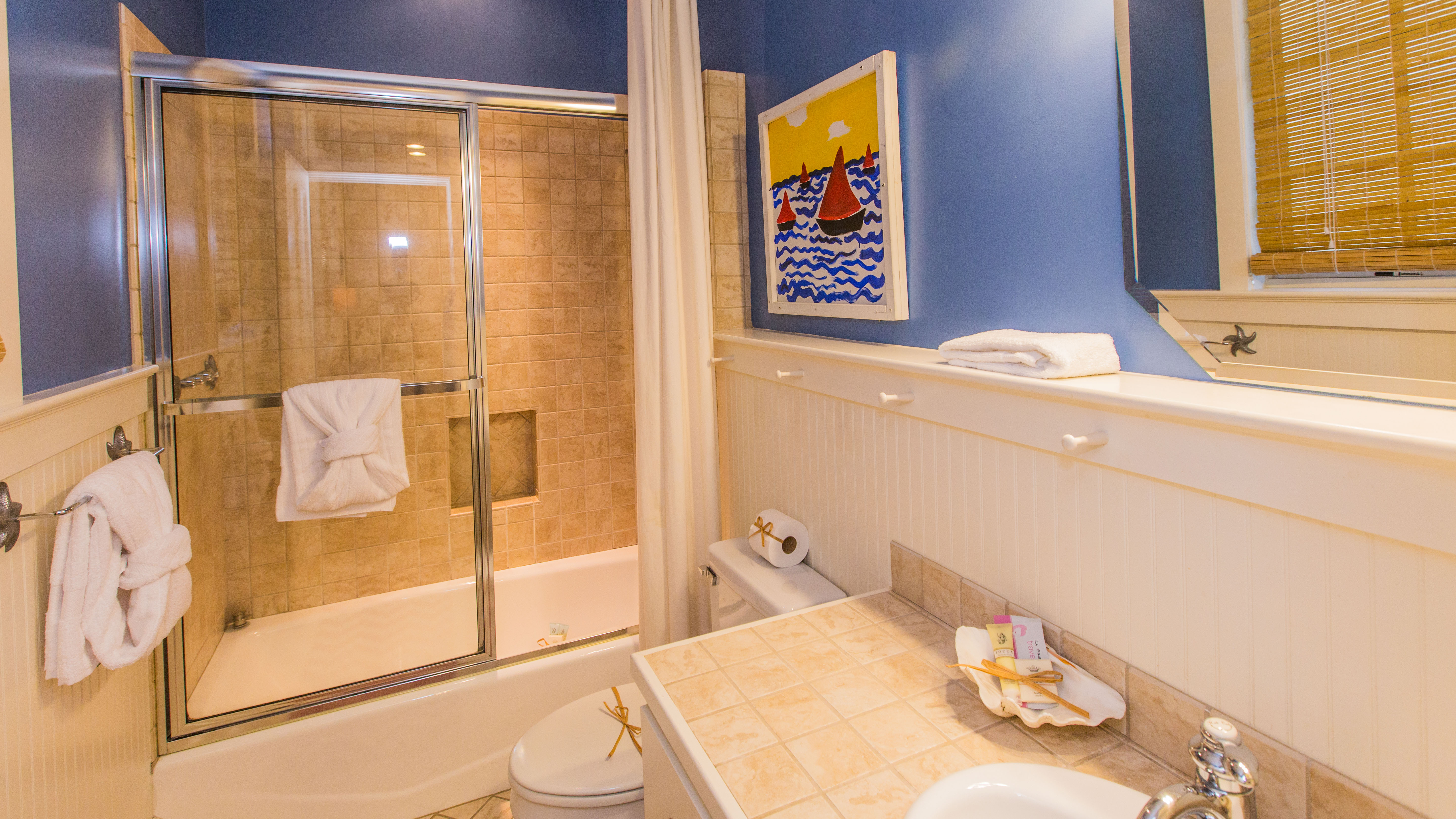 En suite bath has tub/shower combination