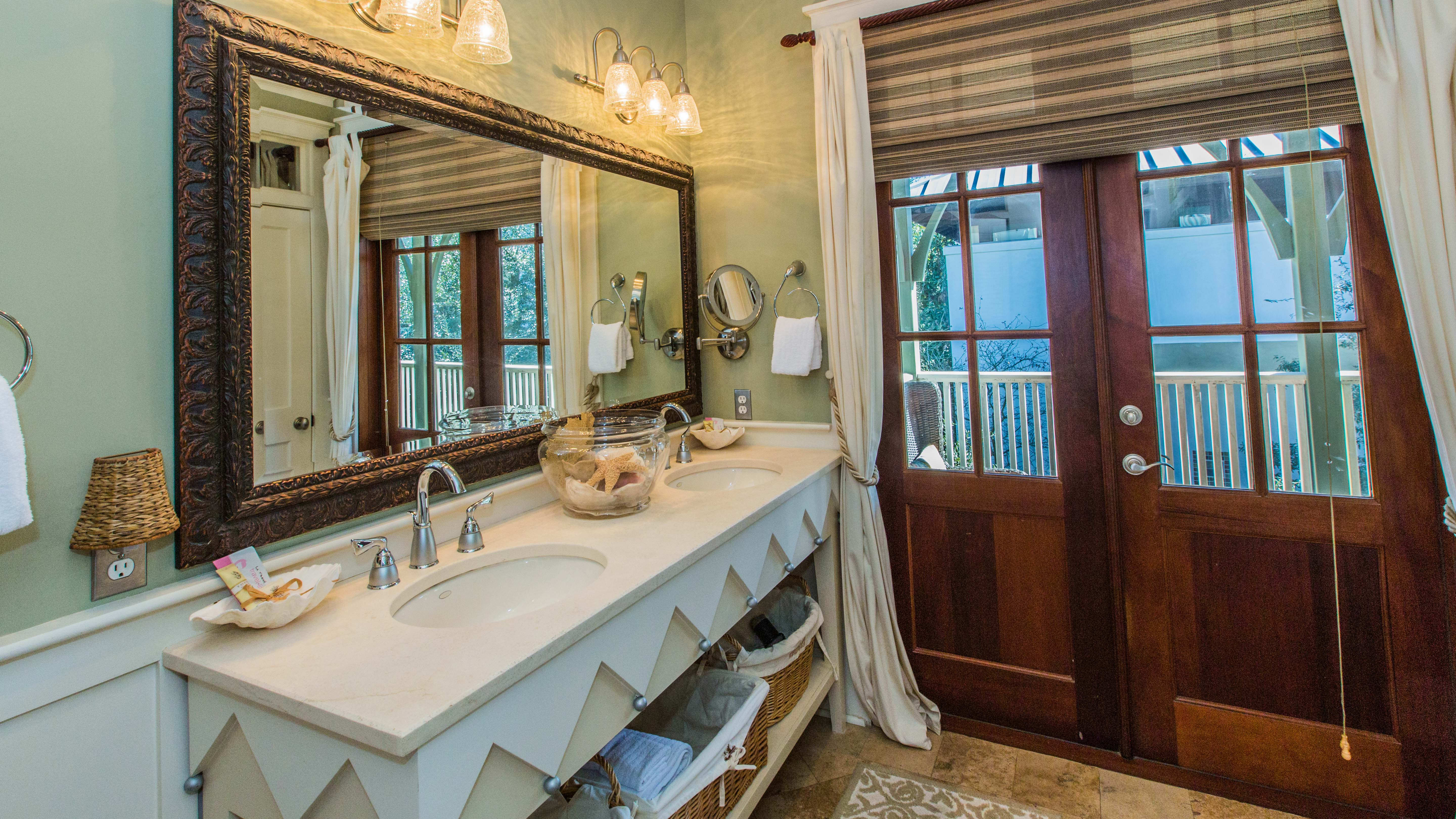 Custom double sinks and view out to private porch