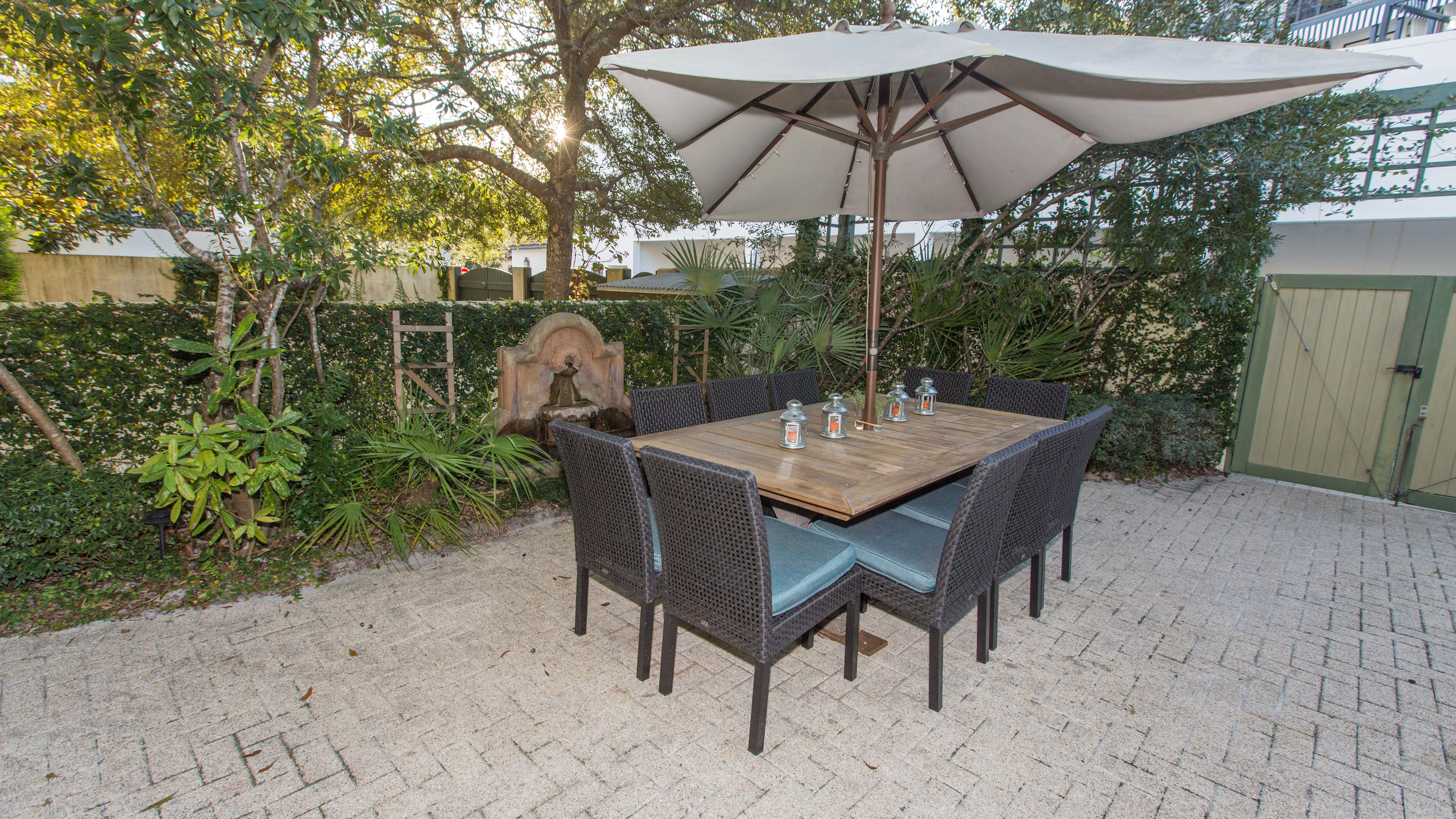 Custom dining table and spacious courtyad